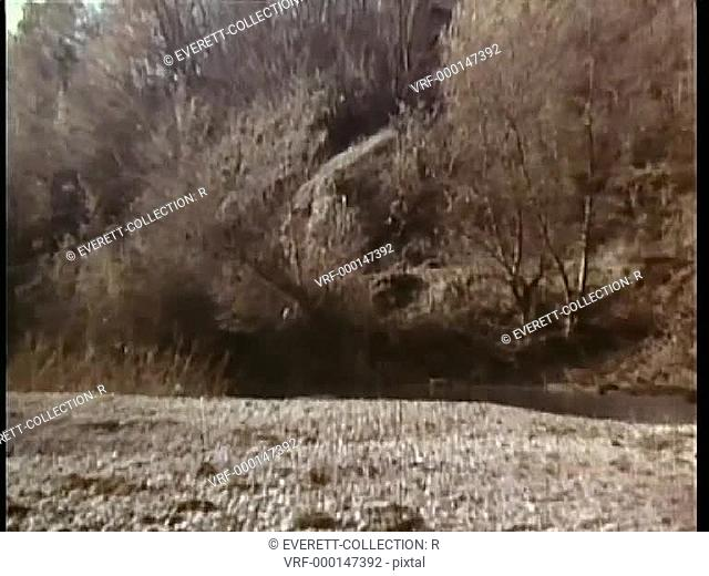 Zoom in to soldiers waiting in ambush