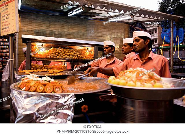 Chefs preparing Indian snacks at a food stall, Chandni Chowk, Old Delhi, India
