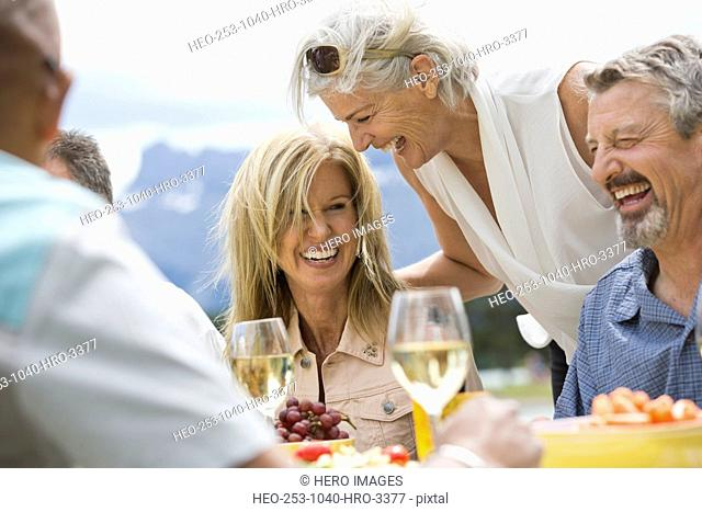 Mature woman laughing with friends