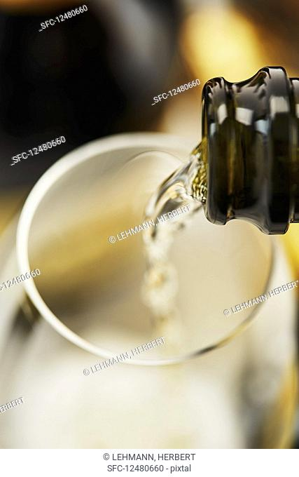 Sparking wine being poured into glasses