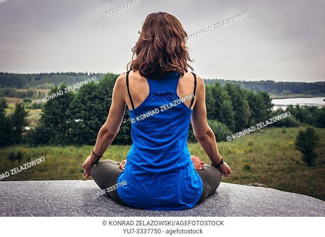 Outdoor yoga near Ozierany water reservoir near Kruszyniany village in Podlasie region of Poland