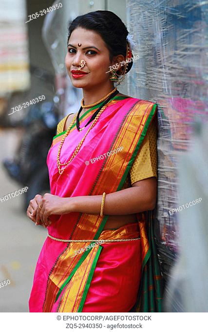 Young Indian girl in Nauwari sari , traditional Maharashtrian sari