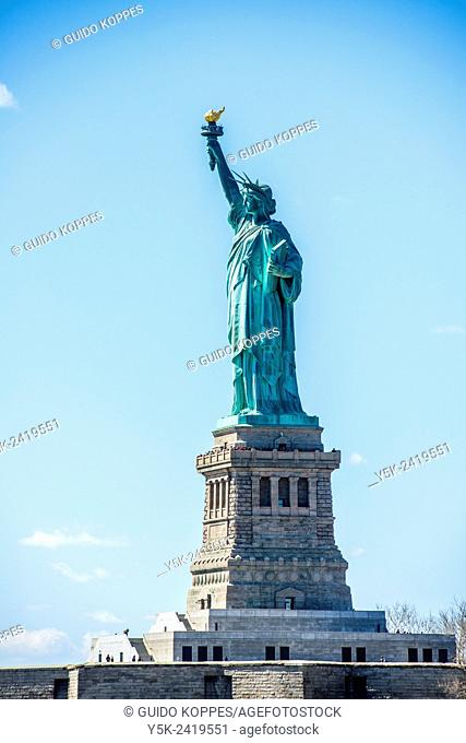 New York, USA. View on the Statue of Liberty from a ferry on the Hudson River