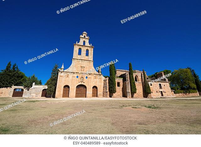 Landmark of facade, bell tower and door of ancient convent of San Francisco de Asis, from thirteenth century, in Ayllon village, in Segovia, Spain, Europe