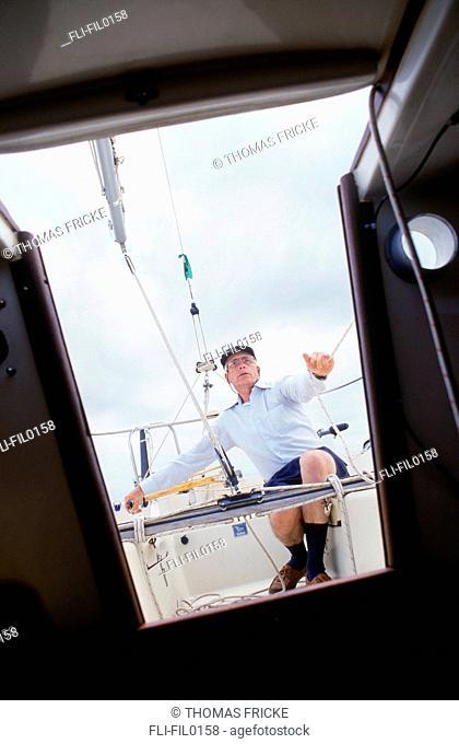 Cabin View of Senior Man Sailing