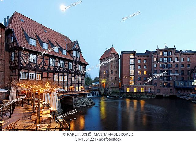 Restaurant terrace on the Ilmenau river, historic salt port with storage tower, Bergstroem four-star hotel, evening mood, old town, Lueneburg, Lower Saxony