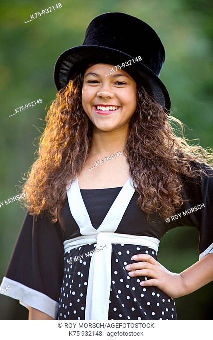 Teen wearing top hat
