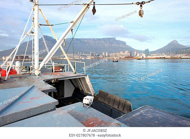A view of Tablew mountain and the city of Cape Town from the upper deck of a fishing trawler boat as it enters the harbour from Table Bay in the Atlantic Ocean
