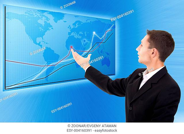 businessman and a modern blue map with charts and graphs
