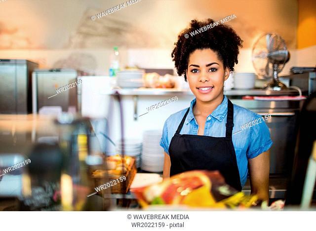 Pretty waitress smiling at camera