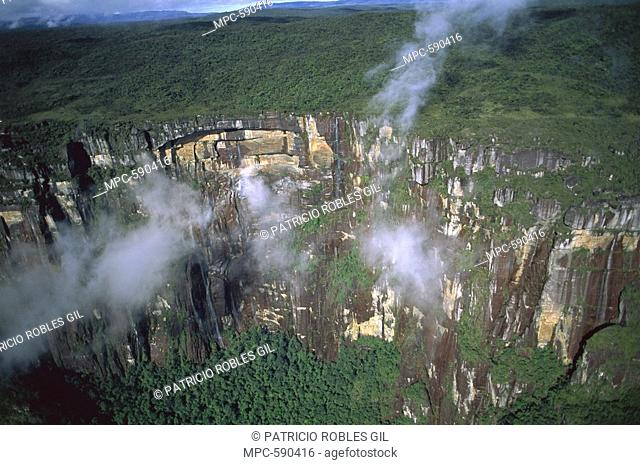MIST SPIRALING IN FRONT OF THE CLIFFS OF THE TEPUI REGION, CANAIMA NATIONAL PARK, VENEZUELA