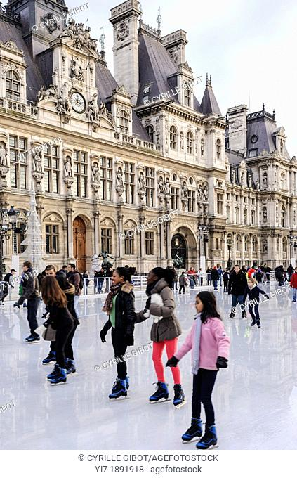 Paris, Ile de France, France, people ice skating in front of the Hotel de Ville, or Paris Town Hall