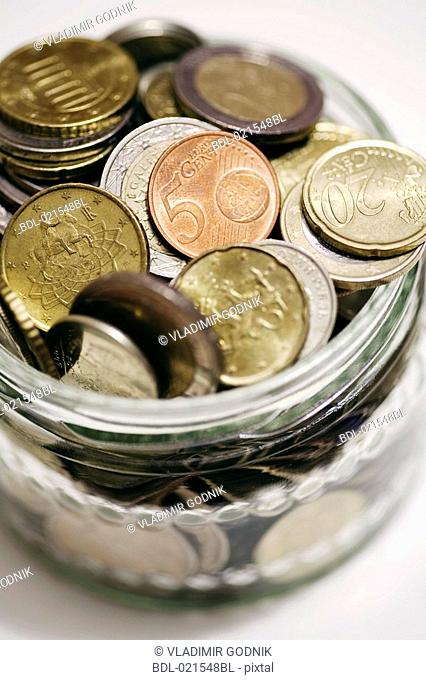 euro coins in glass jar