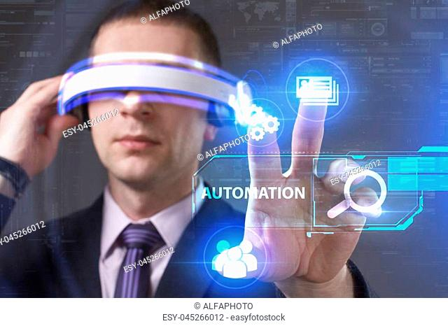 Business, Technology, Internet and network concept. Young businessman working in virtual reality glasses sees the inscription: Automation