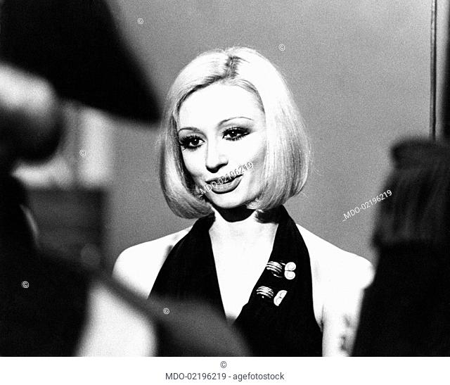 Dancer and presenter Raffaella Carrà in a dress showing her shoulders during the rehearsal of the TV show Milleluci by Antonello Falqui. Rome, 1974