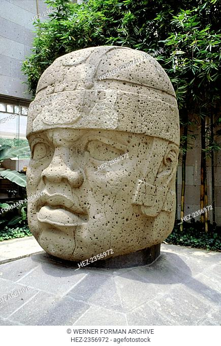 Colossal Olmec head, now at the Jalapa Museum, Veracruz, Mexico, 1250-900 BC. Such heads often weighing many tons are thought to represent individual rulers