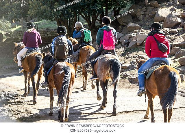 Tourists going on a pony ride at the Somenkong Lodge in Somenkong, Lesotho, Africa