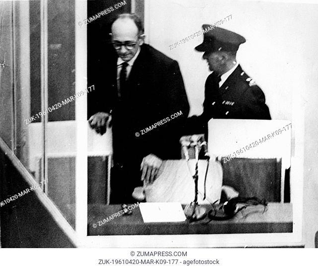 Apr. 20, 1961 - Jerusalem, Israel - Preparing to sit in his armchair the ullet-proof glass dock, during his trial in Jerusalem