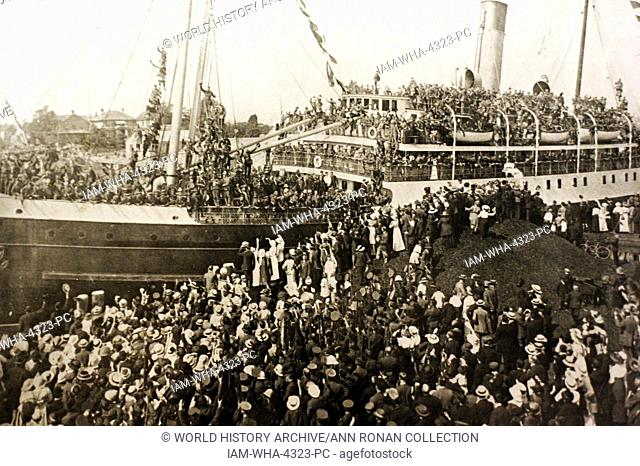 Photograph of a farewell scene at the troopship Princess Sophia in Victoria. The ship prepares to leave with crowds of people gathered at the bankside