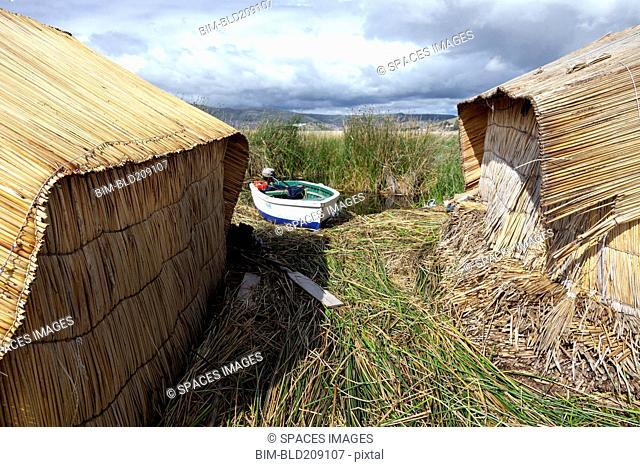 Boat mooring between straw huts