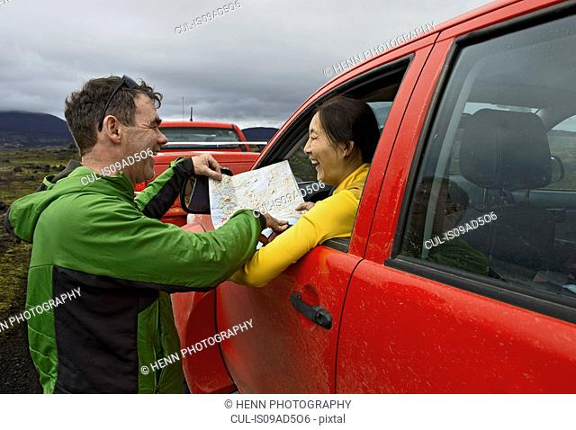 Couple reading map by customised SUV, Fjallabak,Iceland