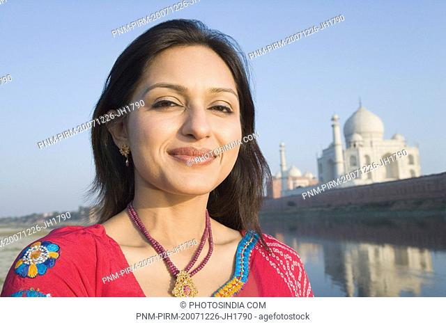 Portrait of a woman with a mausoleum in the background, Taj Mahal, Agra, Uttar Pradesh, India