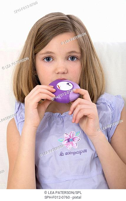 Girl using asthma medication