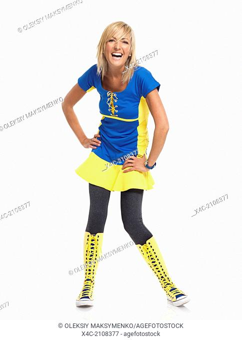 Happy laughing young woman in colorful blue yellow dress and boots isolated on white background