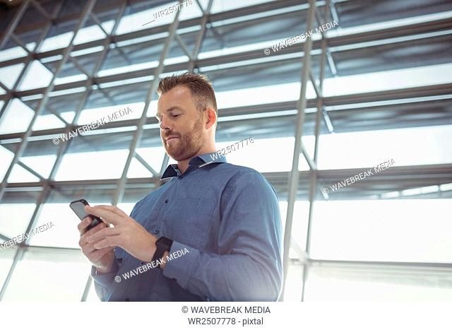 Man using mobile phone in waiting area
