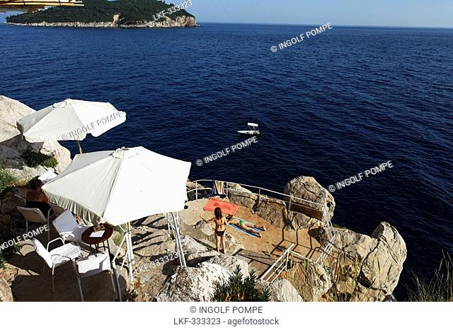 Young people sunbathing on rocks, Dubrovnik, Dubrovnik-Neretva county, Dalmatia, Croatia