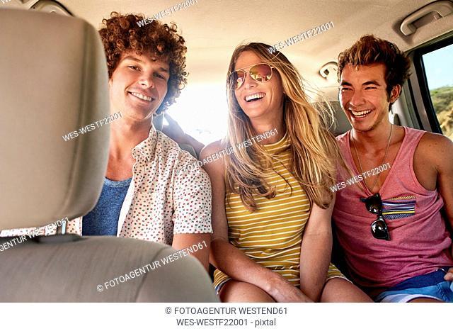 Happy friends in a car