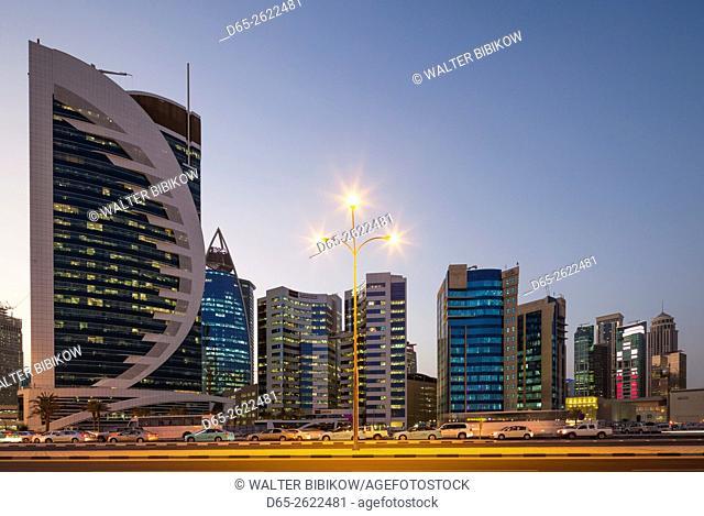 Qatar, Doha, Doha Bay, West Bay Skyscrapers, dusk
