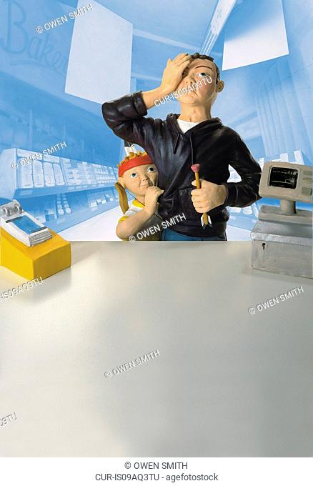 Model of boy with father covering eye in front of pharmacy counter