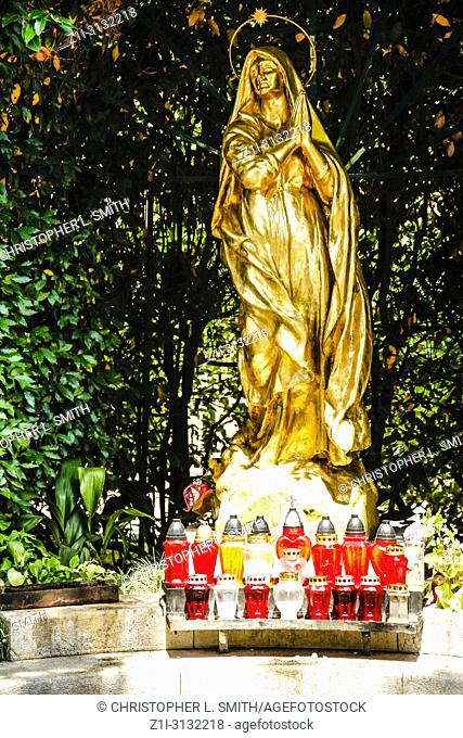The gilded statue of Madonna in front of St Jacob's Church in Opatija, Croatia