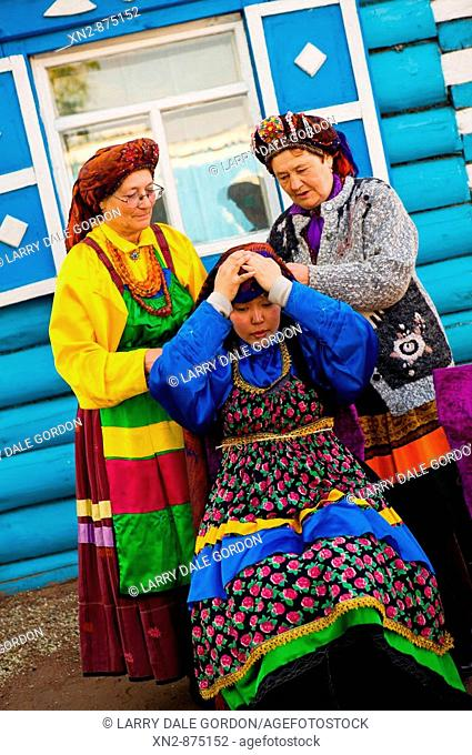 Russia. Tarbagatai Villlage of Old Believers of original Russian Orthodox. Village women making up a young girl in preparation for marriage