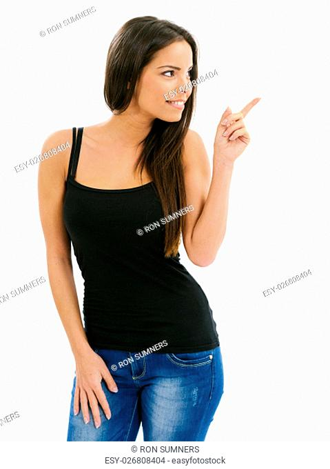 Photo of an isolated beautiful young woman pointing at something on her left