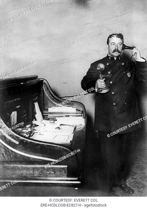 New York City, police department activities, Inspector McCafferty, on telephone, photograph, 1908