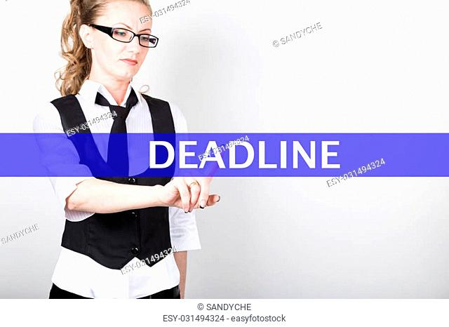 deadline written on a virtual screen. Internet technologies in business and tourism. woman in business suit and tie, presses a finger on a virtual screen