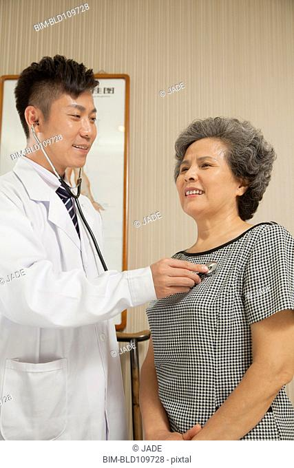 Chinese doctor examining patient in office