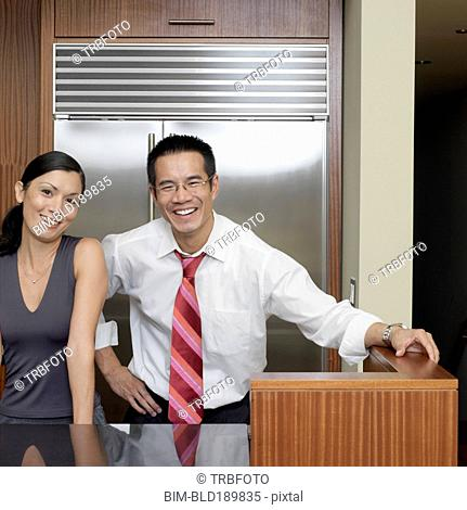 Portrait of Asian couple in kitchen