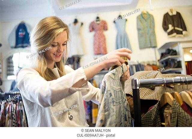 Woman looking at top garment