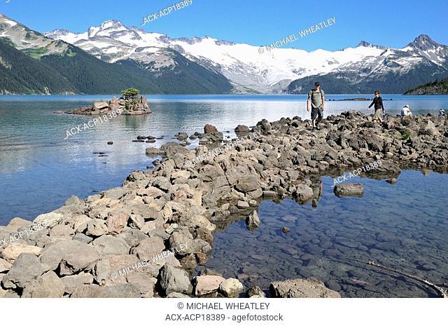 Couple hiking by Garibaldi Lake, Garibaldi Provincial Park, British Columbia, Canada