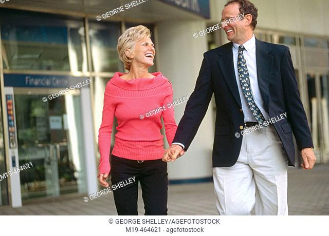 happy couple leaving a financial institution