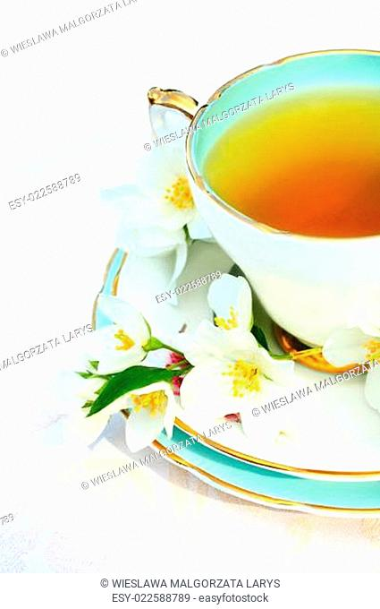 Jasmine flowers and a cup of tea