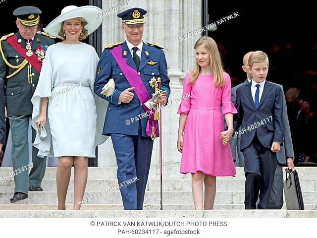 Queen Mathilde of Belgium, King Philippe of Belgium, Crown Princess Elisabeth and Prince Emmanuel walk together after the Te Deum mass at the Cathedral of St