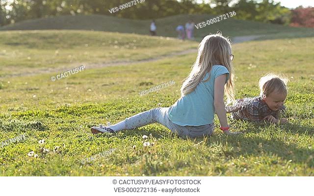Lovely children enjoying time playing in park