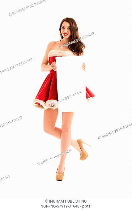 Christmas woman hold big white card. Santa dress. Isolated smiling girl