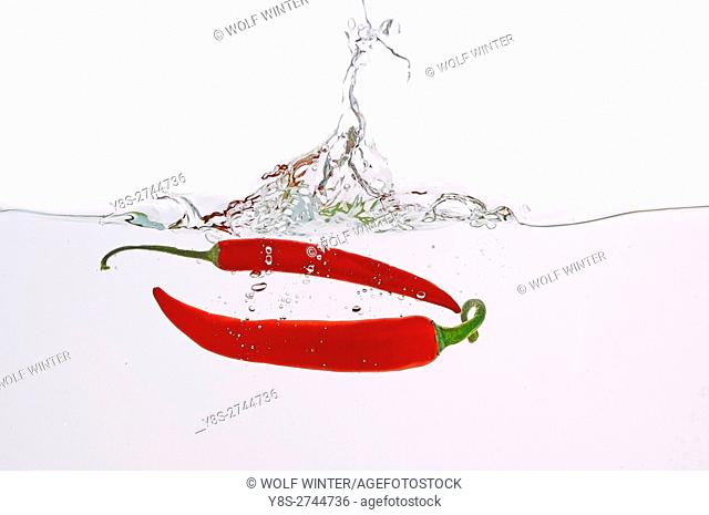 Red pepper(s) thrown into water