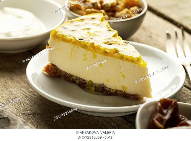 A slice of mascarpone and Greek yoghurt cheesecake with a date and walnut base, topped with maracuja