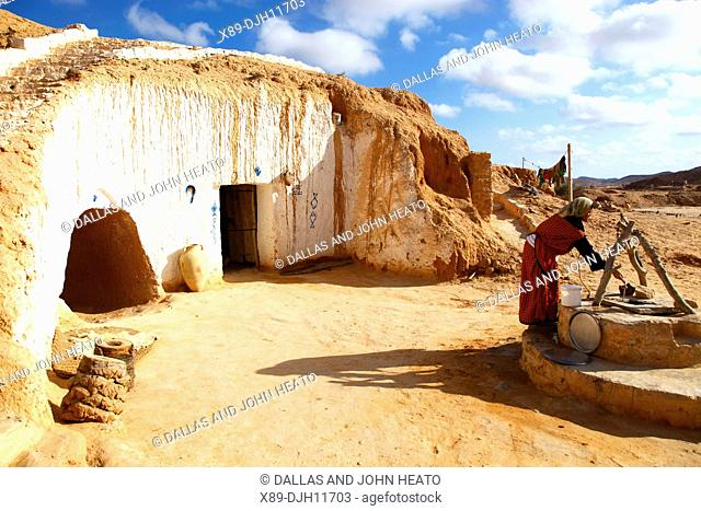 Africa, Tunisia, Matmata, Troglodyte Pit Home, Berber underground Dwelling, Woman at Well
